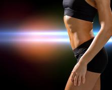 Close up of athletic female abs in sportswear Stock Photos