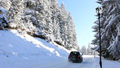 Icy and snowy road on the mountain - stock footage