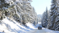 Icy and snowy road on the mountain Stock Footage