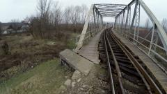 Old railway bridge next to river - aerial shot Stock Footage
