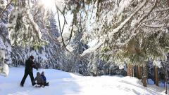 Happy family in the winter vacation Stock Footage