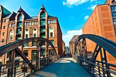 Bridge in famous old speicherstadt in hamburg, build with red bricks Stock Photos