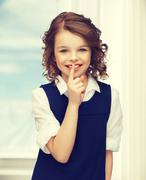 pre-teen girl showing hush gesture - stock photo