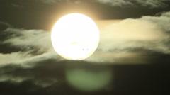 Bright sun disk hide in dark clouds Stock Footage
