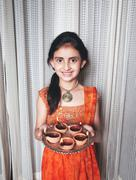 pretty girl with diyas plate on the ocassion of diwali. - stock photo