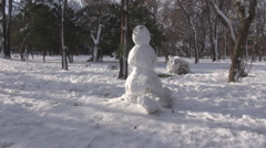 Beautiful snowman in park, childish moments in winter season, cold icy weather - stock footage