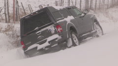 Truck in ditch in severe snow storm and blizzard Stock Footage