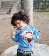 naughty little kid showing victory sign. - stock photo