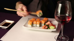 Stock Video Footage of Hand takes sushi with chopsticks