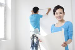 Couple working together for home remodel - stock photo