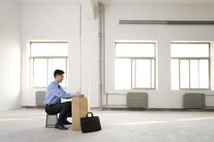 Businessman working in an empty office space Stock Photos