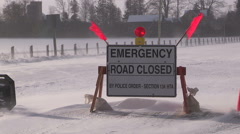 Emergency road closed sign due to blizzard and blowing snow Stock Footage