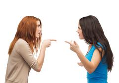 Two teenagers having a fight Stock Photos