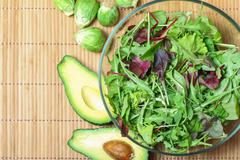 Fresh green salad with spinach,arugula,rom aine and broccoli and avocado Stock Photos