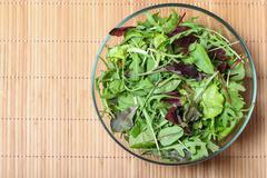 fresh green salad with spinach,arugula,rom aine and lettuce - stock photo