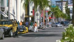 Tourists take pictures of cars on Rodeo Drive in Beverly Hills in Los Angeles 4K Stock Footage