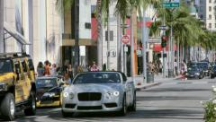 Luxury cars on Rodeo Drive in Beverly Hills in Los Angeles California 4K Stock Footage