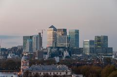 view of canary wharf from greenwich hill at dusk - stock photo