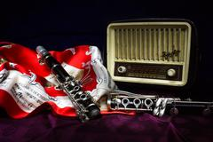 clarinet, wind instrument, disassembled and placed in the case - stock photo
