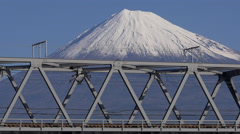 Stock Video Footage of Shinkansen Train Crosses Fujikawa near Mount Fuji in Japan