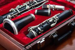 Clarinet, wind instrument, disassembled and placed in the case Stock Photos