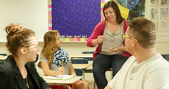 Teacher having a discussion with students and teaching class. Ultra HD 4K Stock Footage
