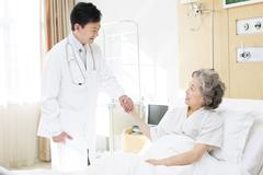Doctor with patient in hospital Stock Photos