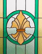 particularly the craftsmanship of a stained glass window - stock photo