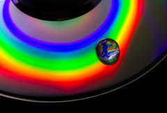 the light reflected from a cd is a collection of psychedelic colors - stock photo