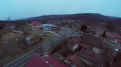 Aerial flight over village Stock Footage