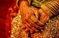 henna on brides hands - stock photo