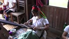 Inle Lake, Indein Market, Padaung woman weaving. - stock footage