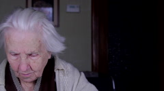 Portrait Of A 99 Years Old Woman Reading, Senescence, Old Age, Loneliness, Pan Stock Footage