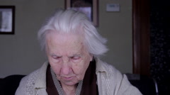 99 Years Old Woman Reading A Calendar Page, Tilt Down - stock footage