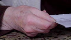 Hand Detail Of A Very Old Woman Holding A Calendar Page - stock footage
