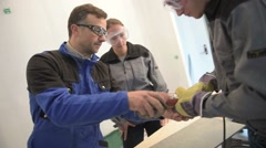 teacher with students in workshop using electric tile saw - stock footage