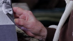 Close Up Of Very Old Woman Hands Flipping Through Photo Album, Tilt Down Stock Footage