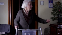 99 Years Woman With Walker Turning Up The Radio Volume, Tilt Down Stock Footage