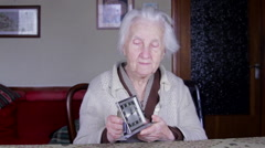 99 Years Old Woman Setting An Old Alarm Clock, Very Old Lonely Woman, Front Shot Stock Footage
