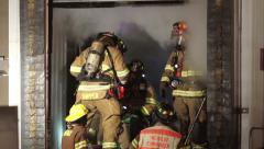 Firefighters Going inside Burning Building Stock Footage
