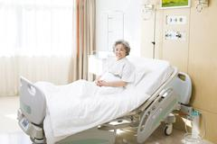 Senior woman in hospital - stock photo