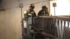 Firefighters on Ladder truck Stock Footage