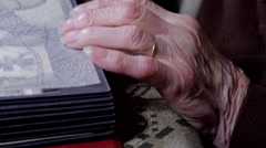 "Very Old Woman""s Hand Detail On A Photo Album, Memories, Tilt Up Stock Footage"