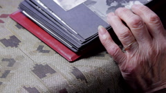 "Very Old Woman""s Hand Detail On A Photo Album, Above Shot, Pan - stock footage"