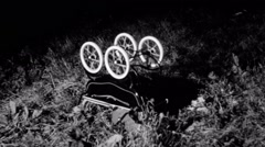 Overturned baby carriage with wheels in motion Stock Footage