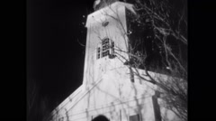 Man jumping to his death from top of church tower Stock Footage