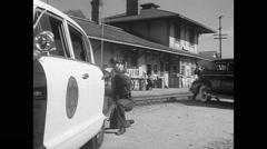 Police shootout at railroad station, 1950s Stock Footage