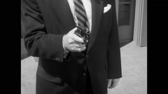 Man removing gun from jacket and shooting Stock Footage