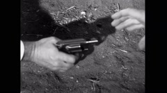 Two men fighting over gun on the ground Stock Footage