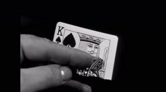 Close-up of torn king of hearts card in man's hand Stock Footage